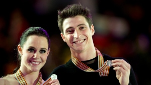 Ice dance silver medalists Tessa Virtue and Scott Moir show off their medal during medal ceremonies at the World Figure Skating Championships in London, Ont., Saturday, March 16, 2013. (Paul Chiasson / THE CANADIAN PRESS)