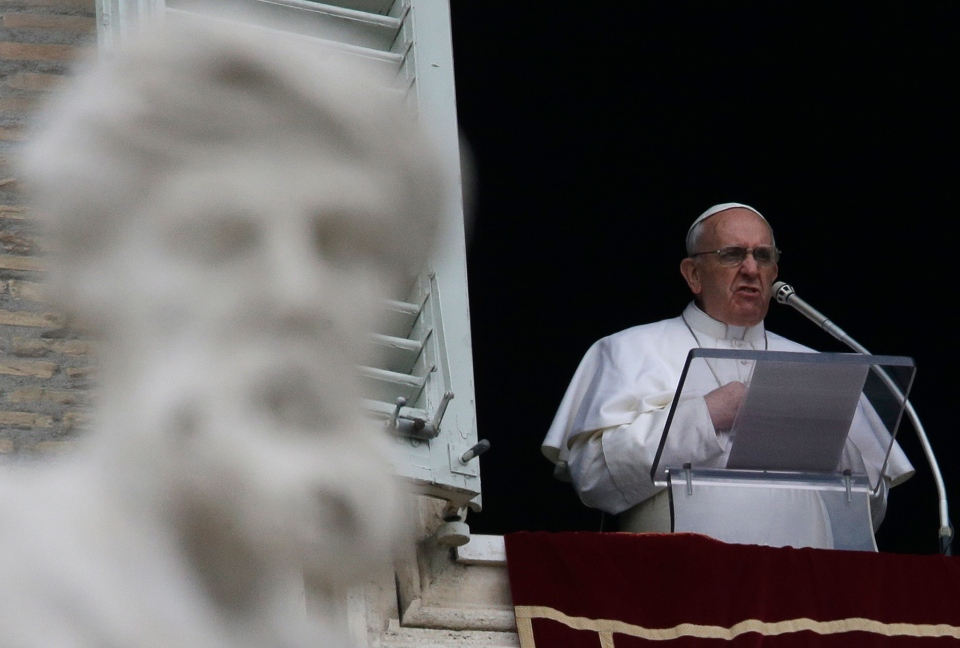 Pope Francis delivers his Angelus prayer from the window of his studio overlooking St. Peter's Square, at the Vatican, Sunday, March 17, 2013. (AP / Gregorio Borgia)