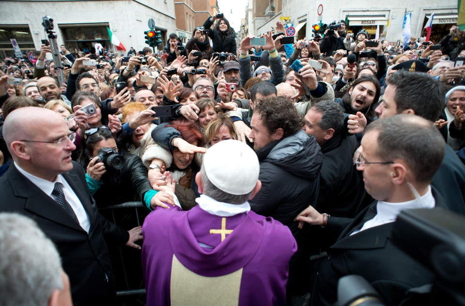 In this photo provided by the Vatican paper L'Osservatore Romano, Pope Francis greets faithful from a side gate of the Vatican, Sunday, March 17, 2013.  (AP / L'Osservatore Romano)