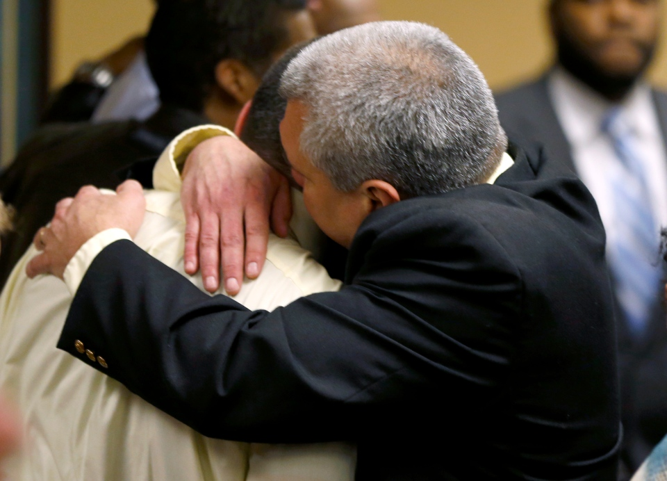 Trent Mays, 17, left, gets a hug from his father after Trent and co-defendant Ma'lik Richmond, 16, were found delinquent on rape and other charges after their trial in juvenile court in Steubenville, Ohio, Sunday, March 17, 2013. (AP / Keith Srakocic)
