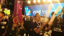 party members cheer at liberal vote