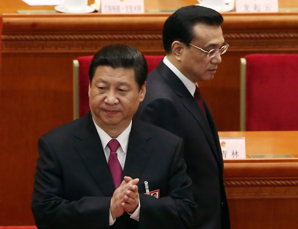 China's new President Xi Jinping, left, and newly installed Premier Li Kiqiang arrive to the closing session of the National People's Congress at the Great Hall of the People in Beijing China, Sunday, March 17, 2013. (AP Photo/Kin Cheung)