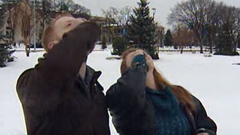 Activists take entire bottles of a homeopathic flu remedy in Memorial Park on Saturday.