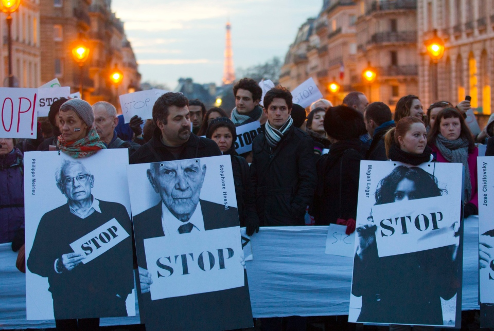 Anti-Syrian regime protesters hold placards near the Pantheon during a protest to mark the second anniversary of the uprising, in Paris, France, Friday, March 15, 2013. (AP / Jacques Brinon)