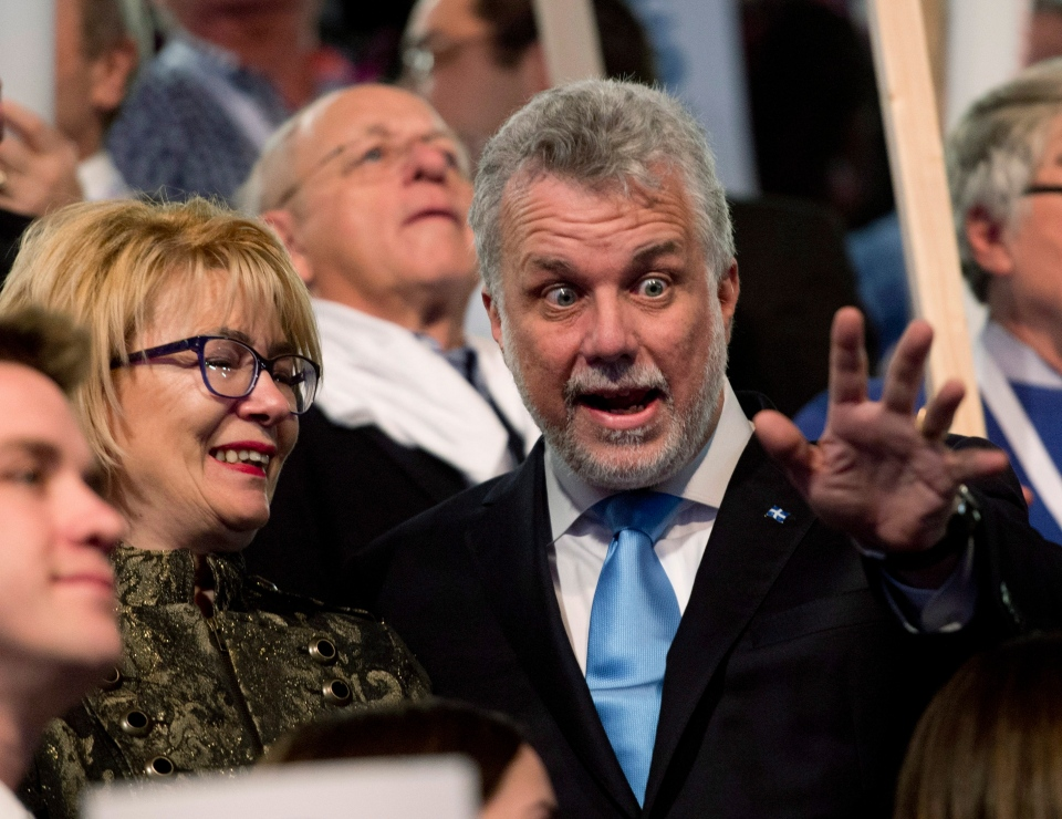 The new Quebec Liberal Party Leader Philippe Couillard, right, reacts to the crowd as his wife Suzanne Pilote, left, looks on Sunday, March 17, 2013 at the leadership convention in Montreal. (THE CANADIAN PRESS/Jacques Boissinot)