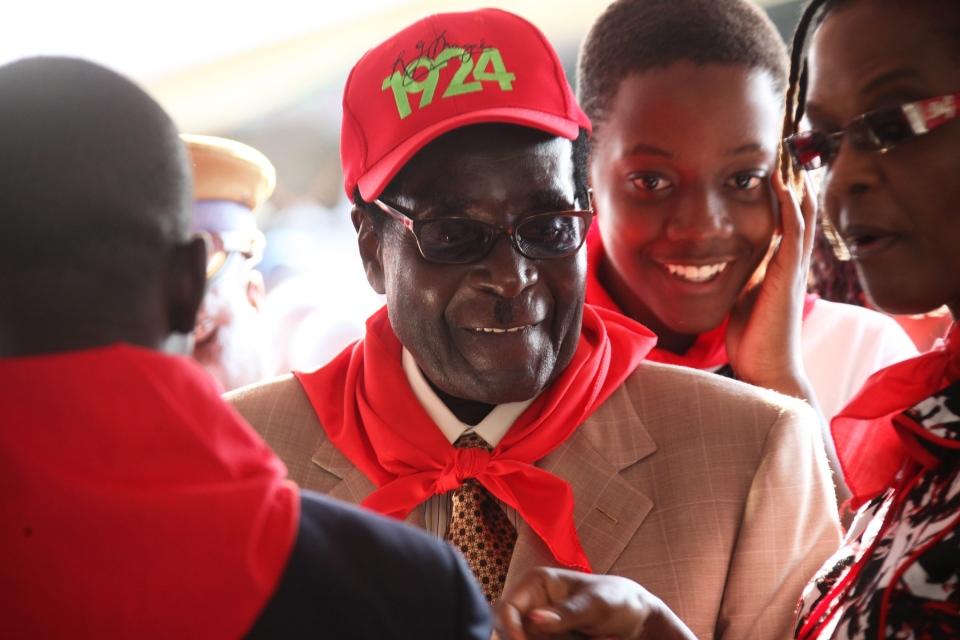 Zimbabwean President Robert Mugabe smiles during celebrations to mark his 89th birthday in Bindura about 100 kilometres north of Harare, Saturday, March, 2, 2013. (AP/ Tsvangirayi Mukwazhi)