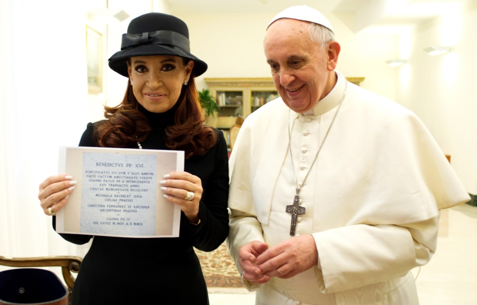 Pope Francis stands by Argentine President Cristina Fernandez showing a picture of a marble plaque commemorating the 1984 peace and friendship treaty between Argentina and Chile, at the Vatican on March 18, 2013. (L'Osservatore Romano)