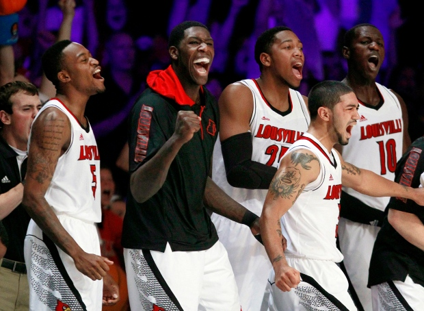 Louisville players cheer on Nov. 23, 2012.