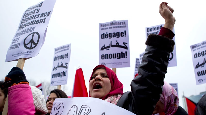 Demonstrators chant slogans during a demonstration against the regime of Egyptian President Hosni Mubarak in Toronto on Saturday Feb. 5, 2011. (Chris Young / THE CANADIAN PRESS)