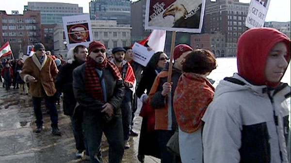 Protesters march and chant during a demonstration against the regime of Egyptian President Hosni Mubarak in Ottawa, Saturday, Feb. 5, 2011.