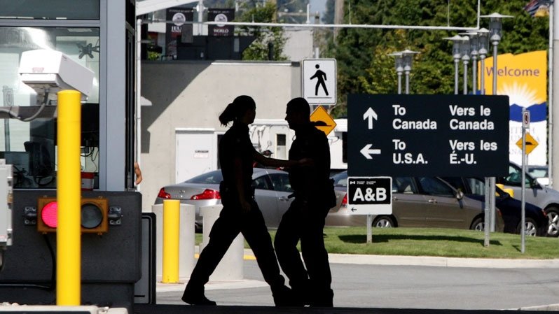 Canadian border officials in Halifax have charged a man after he refused to hand over the passcode for his smartphone, but an expert in the law says it's not clear whether such demands are legal.