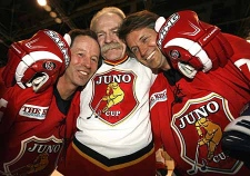 NHL great Lanny McDonald (centre) plays around and puts a glove headlock on musicians Jim Cuddy (right) and Barney Bentall at practice for Friday's Juno Cup hockey game in Calgary on Thursday April 4, 2008. (THE CANADIAN PRESS/Larry MacDougal)
