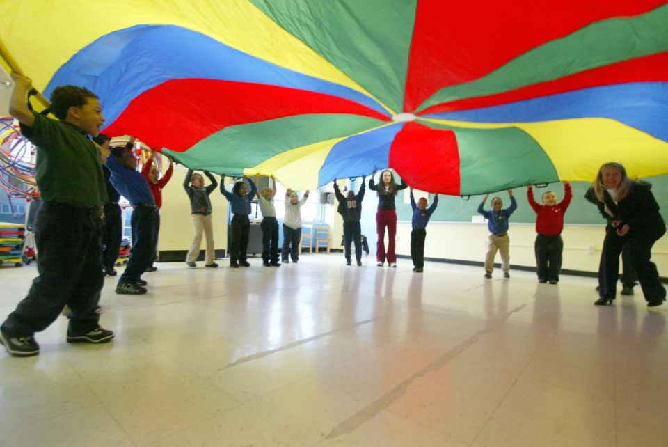 Students play with a parachute at the United Federation of Teachers Elementary Charter School in New York in this 2006 file photo. (AP Photo/Mary Altaffer)