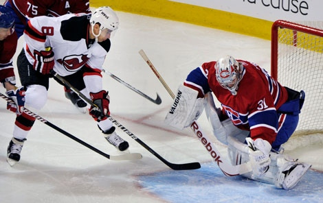 New Jersey Devils' Dainius Zubrus (8) slips the puck past Montreal Canadiens' goaltender Carey Price for a goal during first period NHL hockey action in Montreal, Sunday, February 6, 2011.THE CANADIAN PRESS/Graham Hughes