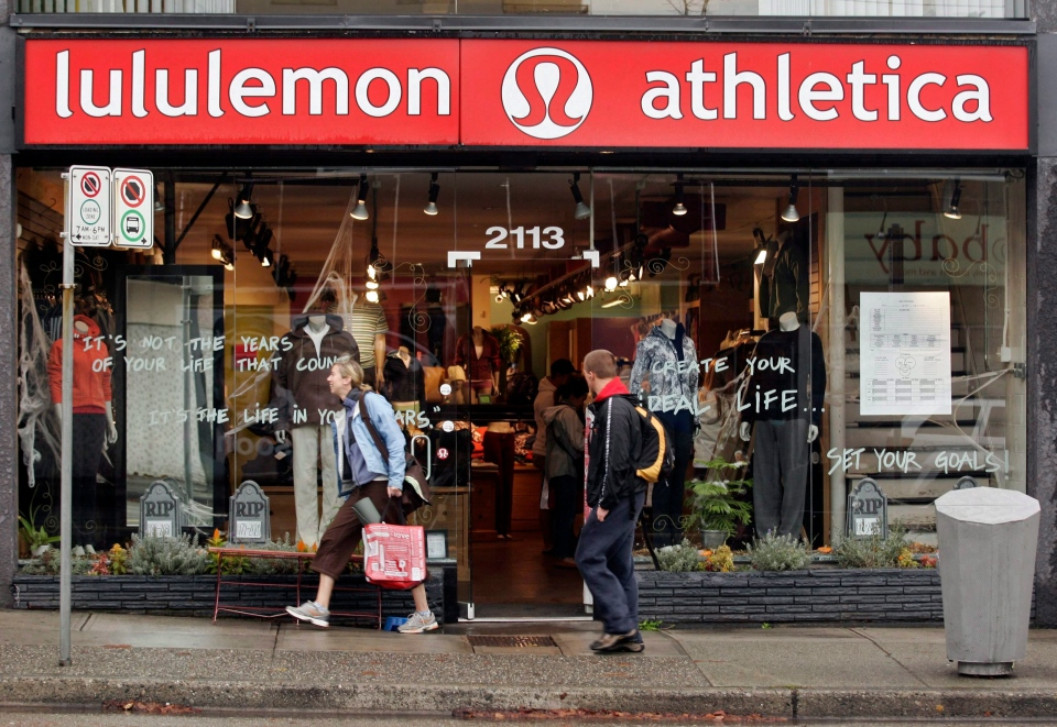 A woman leaves the Kitsilano, B.C. Lululemon store in Vancouver, Thursday, Oct. 18, 2007. (Richard Lam / THE CANADIAN PRESS)