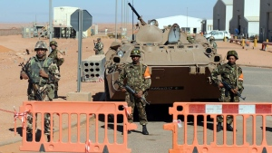 Algerian soldiers stand at the entrance of the gas plant, in Ain Amenas, Thursday, Jan. 31, 2013. (AP)