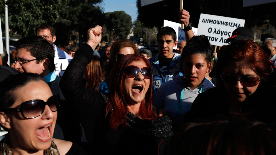 Protesters shout slogans during a protest outside of the parliament in Nicosia, Cyprus, Monday, March 18, 2013. (AP / Petros Karadjias)