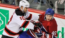Montreal Canadiens' Alexandre Picard (45) is checked by New Jersey Devils' Rod Pelley during first period NHL hockey action in Montreal, Sunday, February 6, 2011.THE CANADIAN PRESS/Graham Hughes