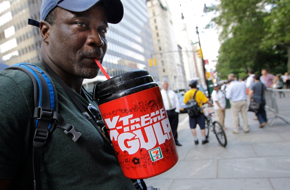 In this July 9, 2012 file photo, protester Eric Moore sips on an extra-large beverage during a protest against Mayor Michael Bloomberg's proposal to prohibit licensed food establishments from using containers larger than 16 ounces to serve high-calorie drinks at City Hall in New York. (AP / Kathy Willens)
