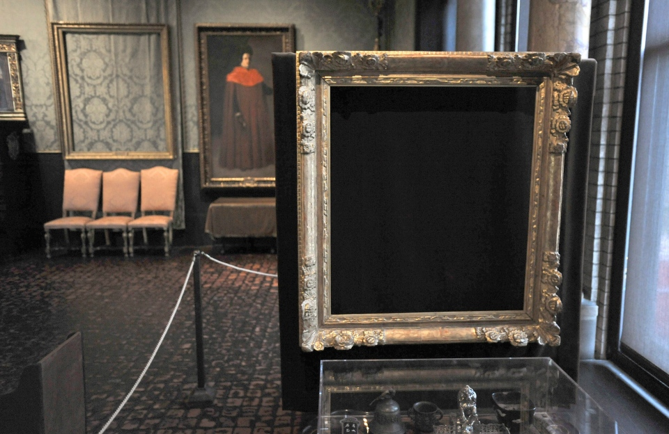 Empty frames from which thieves took 'Storm on the Sea of Galilee,' left background, by Rembrandt and 'The Concert,' right foreground, by Vermeer, remain on display at the Isabella Stewart Gardner Museum in Boston, Thursday, March 11, 2010. (AP / Josh Reynolds)