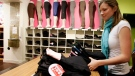 A clerk folds a stack of yoga pants at the Kitsilano Lululemon store in Vancouver in this file photo from Thursday, Oct. 18, 2007. (The Canadian Press/Richard Lam)