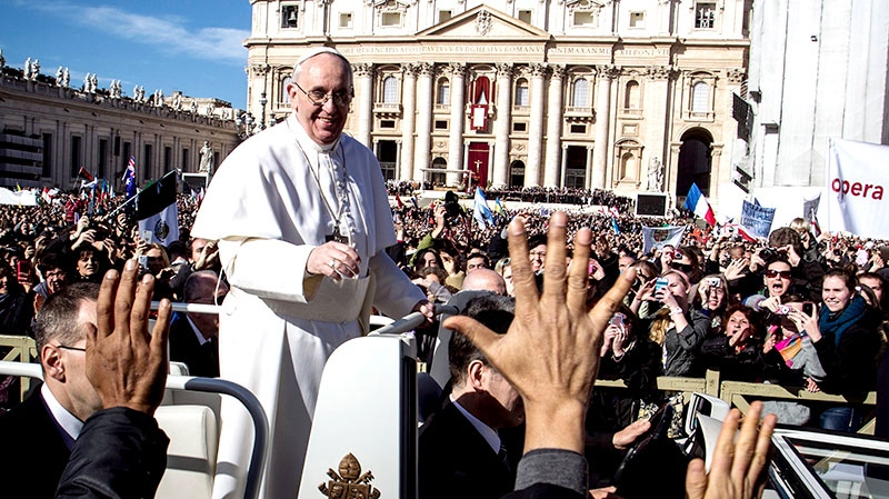 Pope Francis is driven through the crowd in his popemobile in St. Peter's Square for his inauguration Mass at the Vatican, Tuesday, March 19, 2013. (AP / Angelo Carconi)