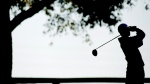 A golfer is silhouetted against the sky as he drives the ball in Bowling Green, Kentucky, in this October 2012 file photo. (AP Photo/The Daily News/Nathan Morgan)