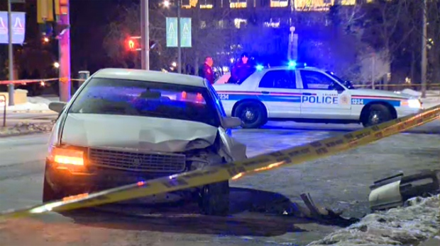 A Cadillac sedan with significant front end damage was located at the intersection of 12 Ave. and 2 St. S.W.