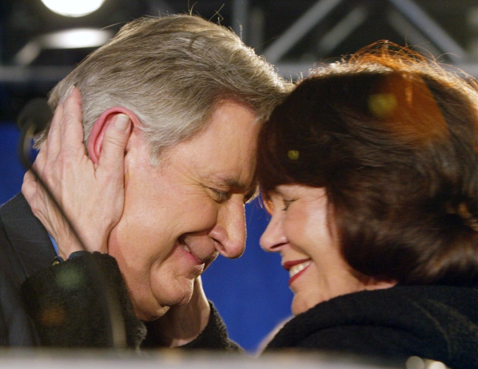 Alberta Premier Ralph Klein and his wife Colleen embrace at his campaign headquarters after winning a fourth consecutive majority government on Monday, Nov. 22, 2004. (Frank Gunn / THE CANADIAN PRESS)