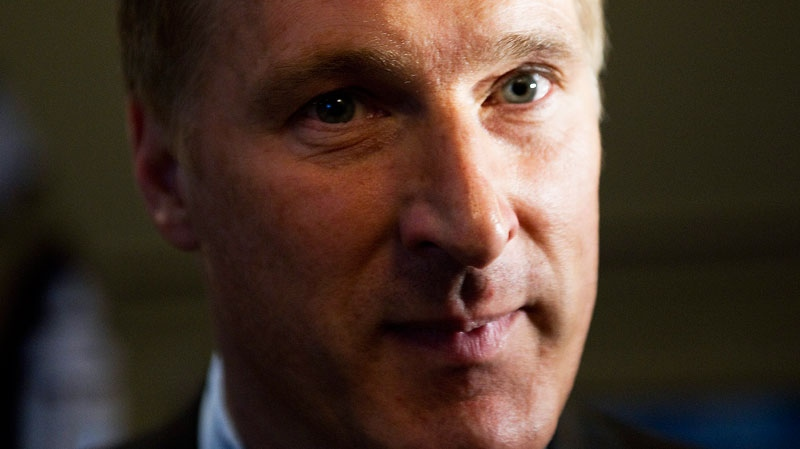 Maxime Bernier, MP for Beauce, Que., arrives on Parliament Hill in Ottawa on Monday Feb. 7, 2011.  (Sean Kilpatrick / THE CANADIAN PRESS)