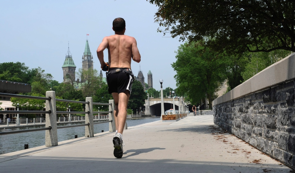 A jogger runs along the Rideau Canal as summer temperatures hit Ottawa on Wednesday, June 8, 2011. A humidex warning has been issued for the nation's capital. THE CANADIAN PRESS/Sean Kilpatrick