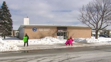 Kevin Mullins and his children protest outside Queen Elizabeth Public School in Kitchener, Ont. on Tuesday, Feb. 8, 2011.