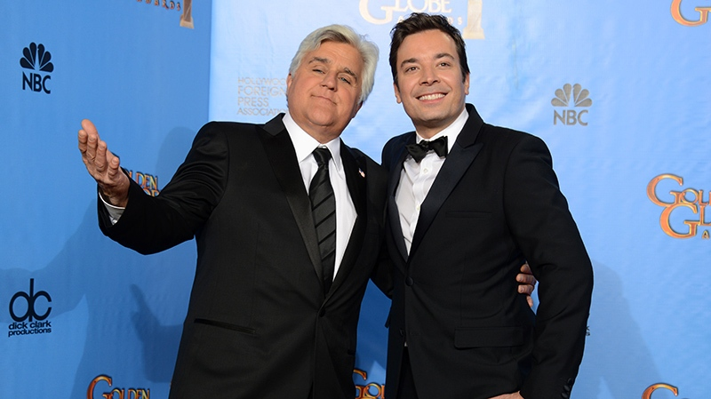 This Jan. 13, 2013 file photo shows Jay Leno, host of 'The Tonight Show with Jay Leno,' left, and Jimmy Fallon, host of 'Late Night with Jimmy Fallon' backstage at the 70th Annual Golden Globe Awards in Beverly Hills, Calif. (Photo by Jordan Strauss / Invision / AP, file)
