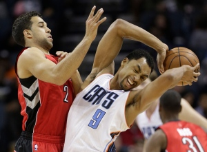 Charlotte Bobcats' Gerald Henderson (9) is fouled by Toronto Raptors' Landry Fields (2) during the second half of an NBA basketball game in Charlotte, N.C., Wednesday, March 20, 2013. . (AP Photo/Chuck Burton)