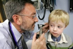 Giancario Gemignani-Hernandez, 2, has his ear examined by Dr. Alejandro Hoberman, at Children's Hospital of Pittsburgh on Nov. 20, 2006. (AP /Gene J. Puskar)