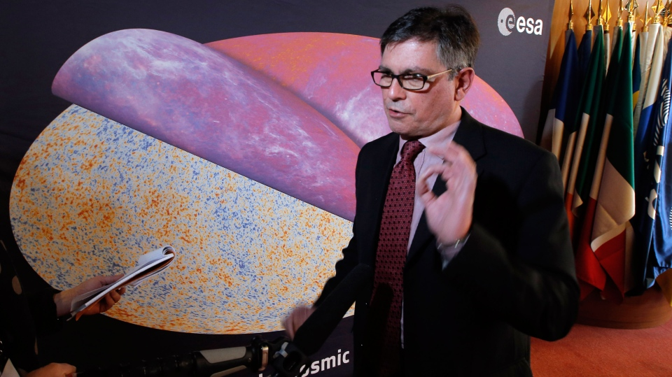 George Efstathiou, a European Space Agency astrophysicist, speaks after the press conference at ESA headquarters, in Paris, in front of the most detailed map ever created of the cosmic microwave background acquired by ESA's Planck space telescope Thursday, March 21, 2013. (AP / Francois Mori)