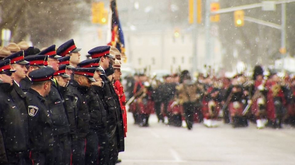 Police officers from across Canada gather in Guelph to pay tribute to fallen policewoman Const. Jennifer Kovach Thursday, March 21, 2013.