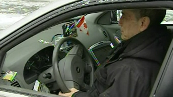 The Canadian flag on the dash of Arieh Perecowicz's taxi netted him $1,400 in fines, which he is fighting in court (Feb. 8, 2011)