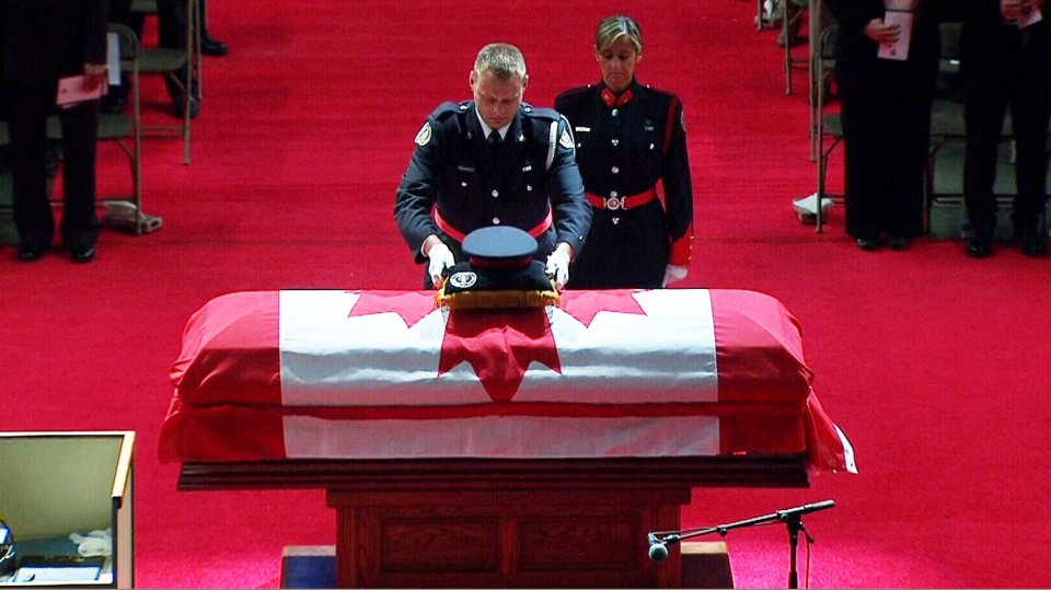 Police officers pay their respects to Const. Jennifer Kovach at her funeral in Guelph, Ont., Thursday, March 21, 2013.