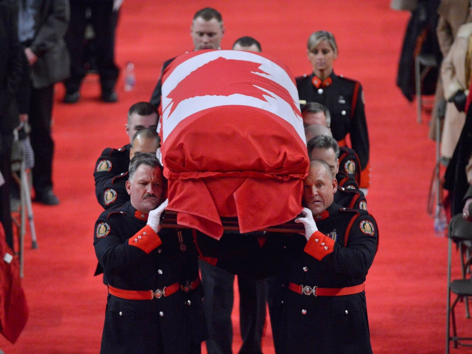 Pallbearers carry the casket of Const. Jennifer Kovach at her funeral in Guelph, Ont., on Thursday, March 21, 2013. (Nathan Denette / THE CANADIAN PRESS)