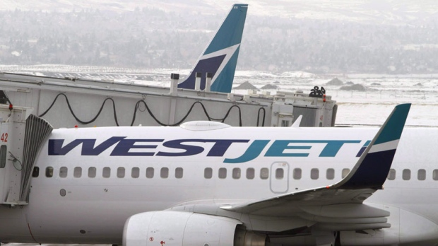 WestJet Airlines planes sit on the tarmac at Calgary Airport on Tuesday Feb. 16, 2010. (THE CANADIAN PRESS/Larry MacDougal)