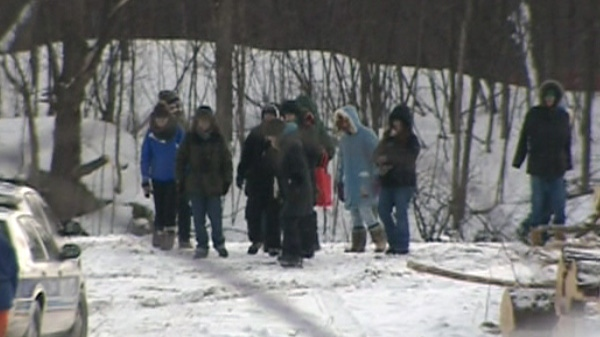 A group of protesters leave the South March Highlands after causing a disruption, Tuesday, Feb. 8, 2011.