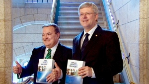 Finance Minister Jim Flaherty and Prime Minister Stephen Harper make their way to the House of Commons to deliver the federal budget on Parliament Hill in Ottawa on Thursday, March 21, 2013.