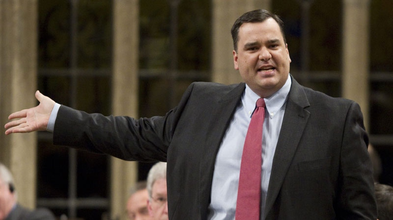 Minister of Canadian Heritage James Moore responds to a question during Question Period in the House of Commons on Parliament Hill in Ottawa, Monday February 7, 2011. (THE CANADIAN PRESS/Adrian Wyld)