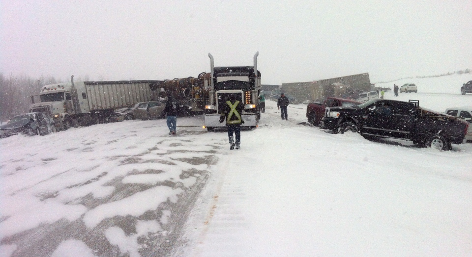 Vehicles litter the highway as more than 100 people have been injured following a multi-vehicle crash in snowy conditions on Highway 2 south of Edmonton on Thursday, March 21, 2013. (Derek Fildebrandt / THE CANADIAN PRESS)