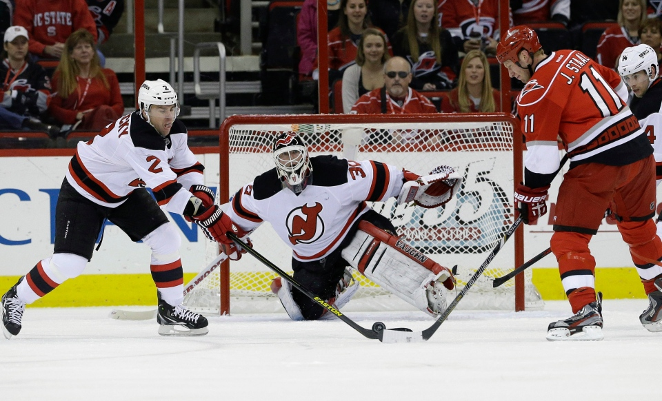 New Jersey Devils goalie Martin Brodeur (30) defends the goal against the Carolina Hurricanes during the first period of an NHL hockey game in Raleigh, N.C., on March 21, 2013. (AP Photo/Gerry Broome)