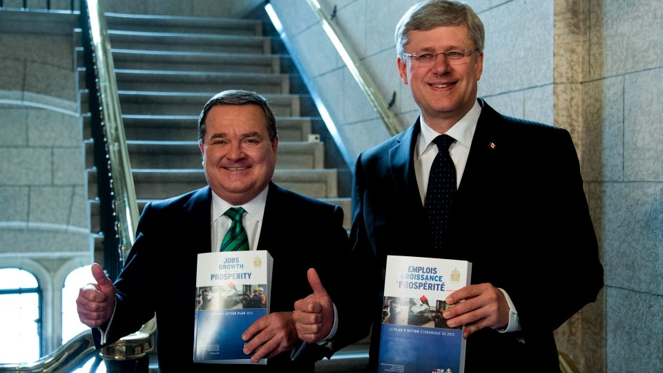 Finance Minister Jim Flaherty and Prime Minister Stephen Harper enter the House of Commons to table the budget on Parliament Hill in Ottawa on Thursday, March 21, 2013. (Patrick Doyle / THE CANADIAN PRESS)