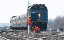 Crews work on the tracks ahead of a VIA Rail passenger train in this February 2012 file photo. (Pawel Dwulit / THE CANADIAN PRESS)