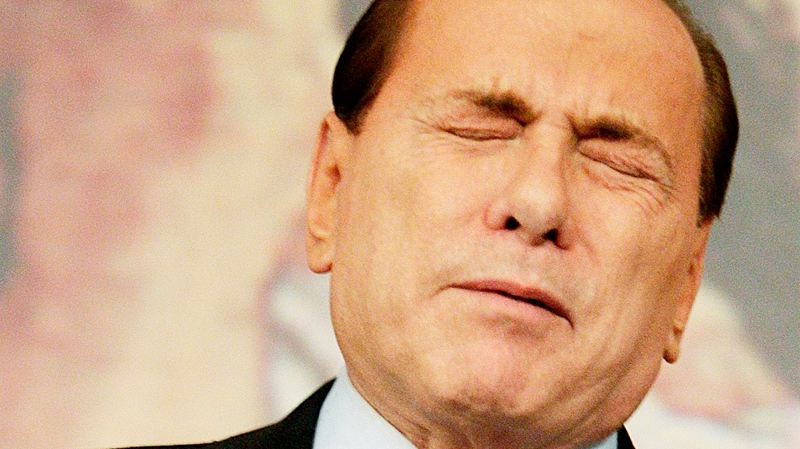 Italian premier Silvio Berlusconi reacts during a press conference following a cabinet meeting at Rome's Chigi palace.  Italian prosecutors requested Wednesday that Premier Silvio Berlusconi stand trial over accusations he paid for sex with a 17-year-old Moroccan and then used his influence to try to cover it up on Wednesday, Feb. 9, 2011. (AP / Pier Paolo Cito)