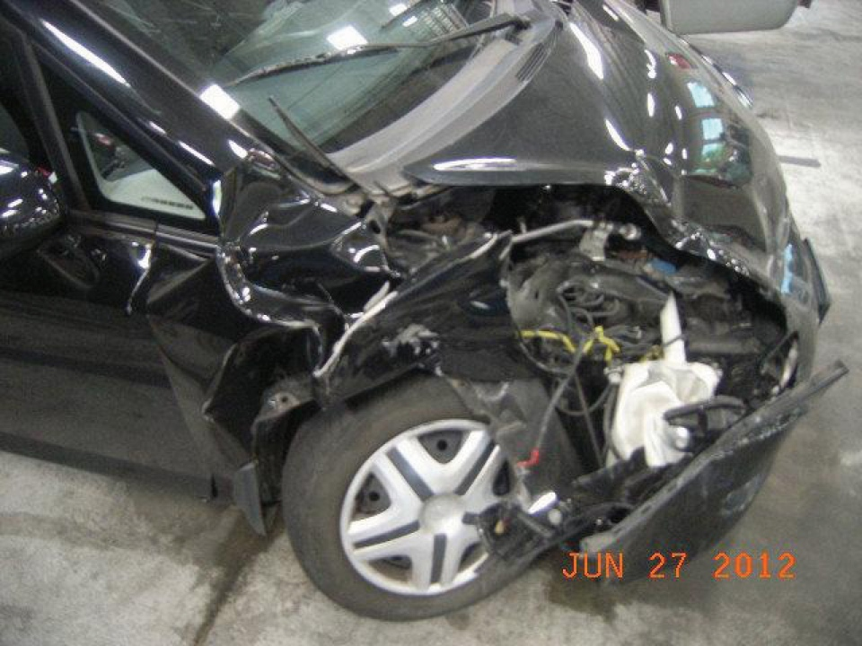 The dealer reported that the frame of this Honda was not damaged. APA investigators found the right side subframe rail was indeed damaged. It was straightened, very crudely re-welded and damage concealed with body filler.